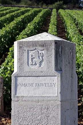 Stone sign for Domaine Faiveley by a vineyard