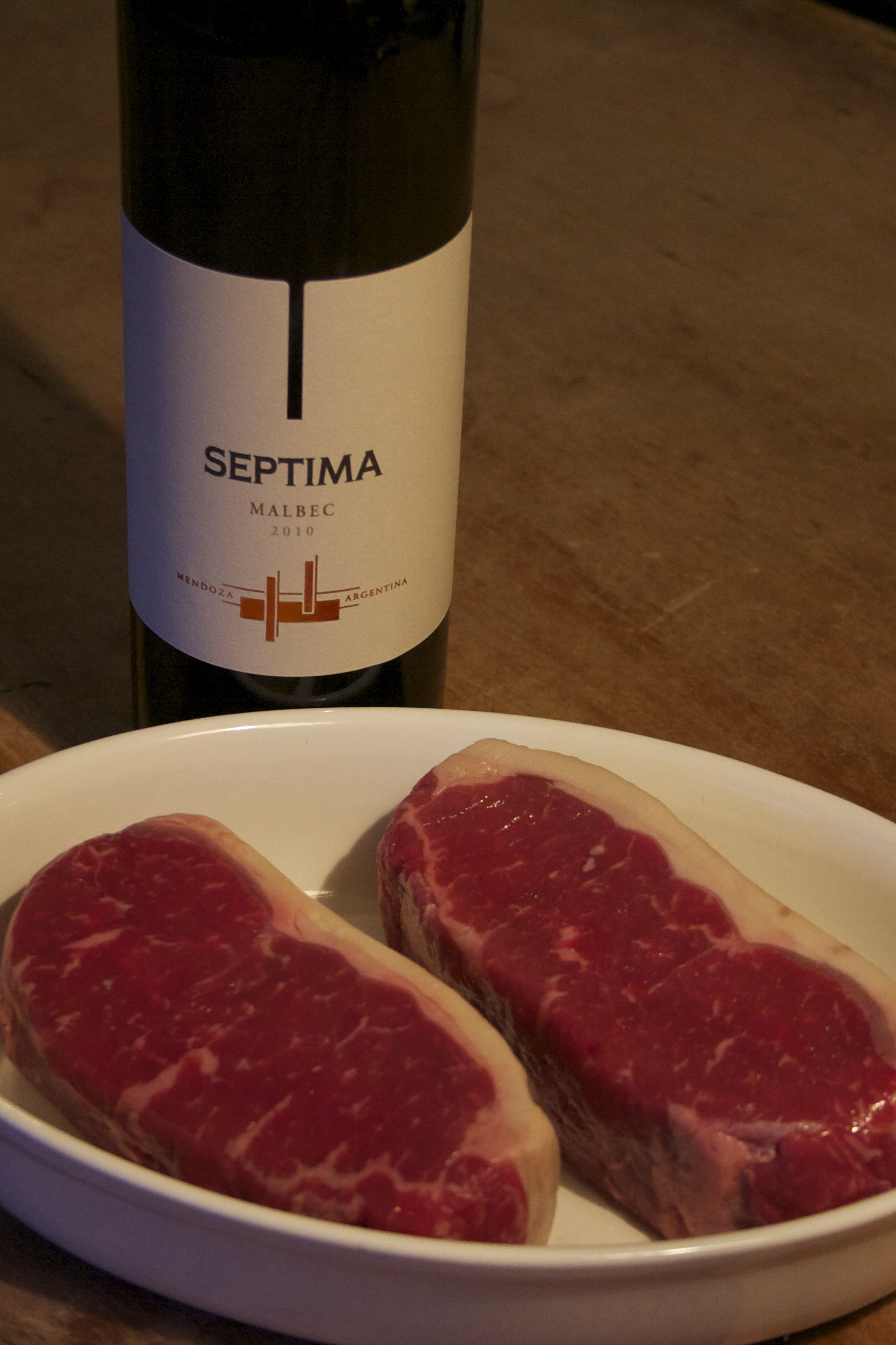 Bottle of Septima Malbe 2010 and two steaks from Argentina