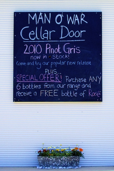 Poster outside the man o war winery cellar door in Waiheke, New Zealand