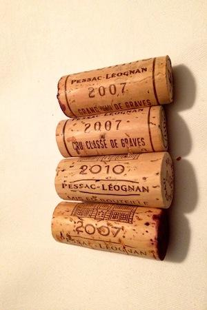 Four corks from bottles of Pessac Leognan